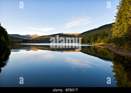 Pentwyn Reservoir (known locally as Dolygaer Lake) in the Brecon Beacons Mid-Wales early evening with reflection - Stock Photo
