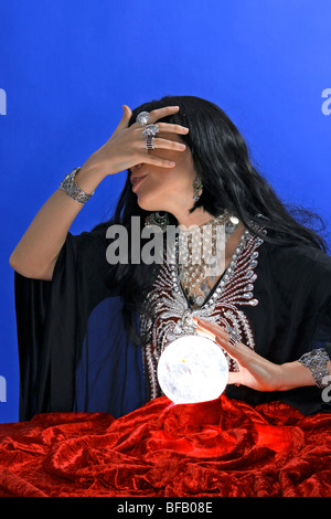 Fortune teller with crystal ball - Stock Photo