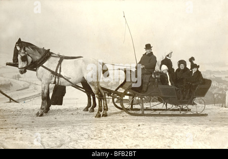 Five People Riding in Horse Drawn Sleigh - Stock Photo