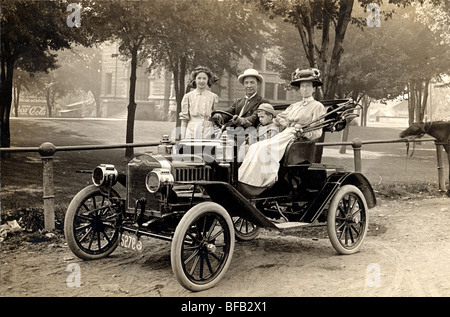 Family in New Compact Automobile - Stock Photo
