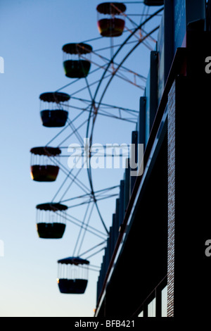 Restaurant against the background of Sydney's Luna Park ferris wheel. - Stock Photo