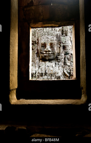 Face carving at the Bayon temple, Angkor Thom, Cambodia - Stock Photo