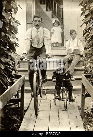 Father & Son in Parallel on Bicycles - Stock Photo