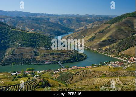 Portugal, the Douro Valley, Pinhão seen over terraced vineyards, from the miradouro de Casal de Loivos - Stock Photo
