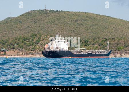 The Tanker ASPERELLA DOUGLAS delivers fuel oil ashore from its moorings in Kool Baai, Sint Maarten - Stock Photo