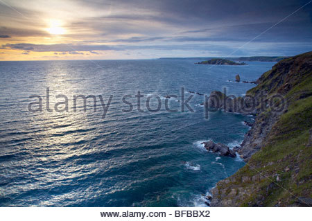 Coastline to Burgh Island at sunset, Bigbury Bay, near Bantham, South Devon, England, UK - Stock Photo