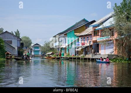 Houses on the water. Dal Lake canal backwaters. Srinagar. Kashmir. India - Stock Photo
