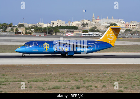 Malmo Aviation Avro RJ100 in special colours departing from Malta - Stock Photo