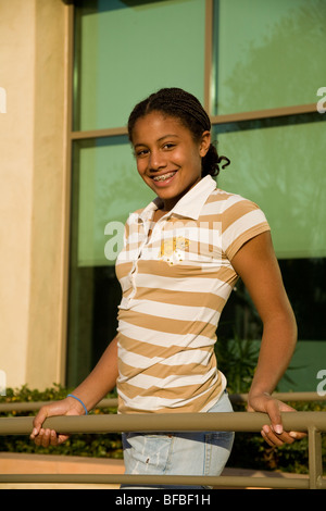African American Junior high girl with braids happily smiling and posing for camera. MR ©Myrleen Pearson - Stock Photo
