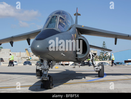 French Air Force Alpha Jet military training plane parked on airport apron - Stock Photo