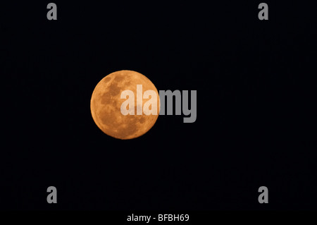 The full moon rising over the Andes Mountain Range in Santiago de Chile - Stock Photo