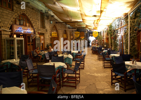 indoor covered walkway bars and souvenir shops in the old town Limassol lemesos republic of cyprus europe - Stock Photo