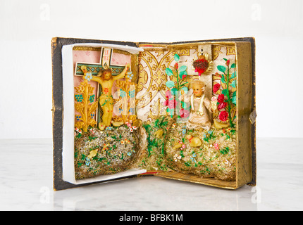 altar in an old family book antique antiquity religion religious religiousness devoutness valuable precious piety - Stock Photo