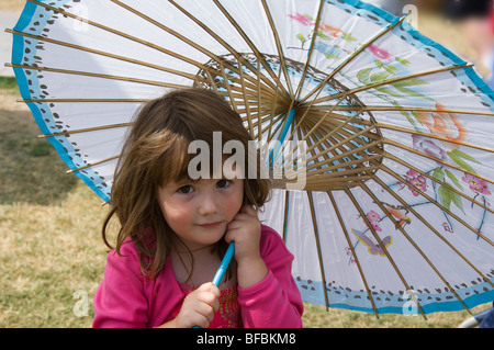 Girl with parasol, enjoying RHS Flower Show - Stock Photo