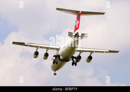 Avro RJ100 operated by Swiss International Air Lines on approach for landing at Birmingham Airport - Stock Photo