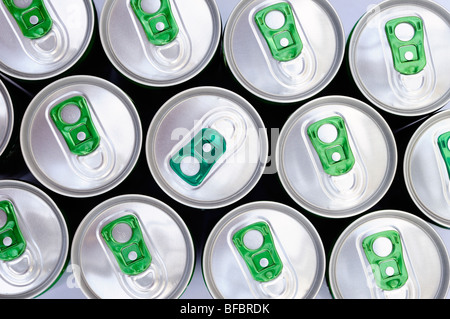 Organized rows of green ring pull drinks can tops with one different colour top in opposite orientation - Stock Photo
