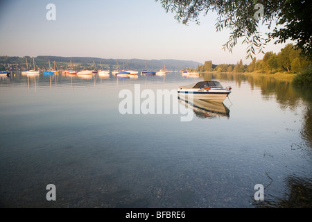 Boats at sunset on Lake Constance (Bodensee) - Stock Photo