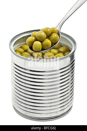 Preserved peas vegetable in metal spoon closeup - Stock Photo