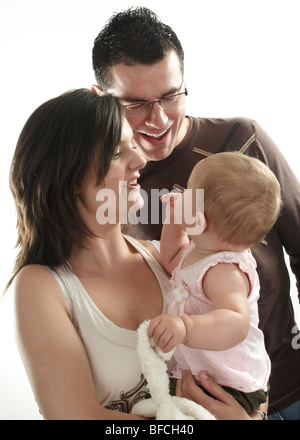 family portrait of mum, dad and baby girl - Stock Photo