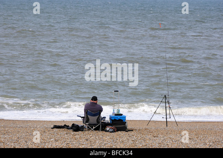 Fishing off the beach at Cley Eye, Cley next the Sea, Norfolk, England, UK. - Stock Photo