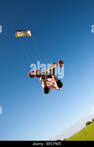 Extreme sport, freestyle kite landboarding, flying inland in open field - Stock Photo