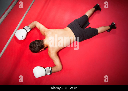 Young adult man knocked down. Copy space - Stock Photo