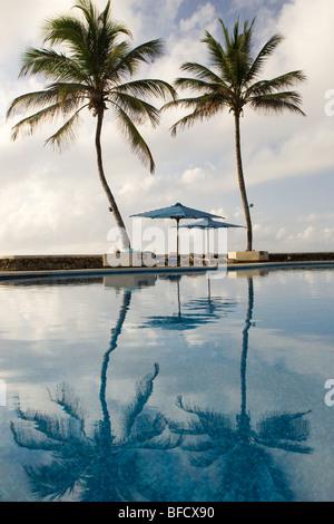 Pool area reflections at Hemingways Resort - Watamu, Kenya - Stock Photo