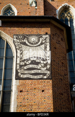 Sundial / Sun dial on the wall at St Marys Basilica. St Mary's Square, Krakow. Poland. - Stock Photo