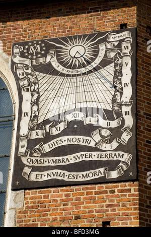 Sundial on the wall at St Marys Basilica. St Mary's Square, Krakow. Poland. - Stock Photo