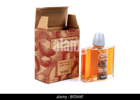 French Aftershave Lotion bottle and packaging against a white background - Stock Photo
