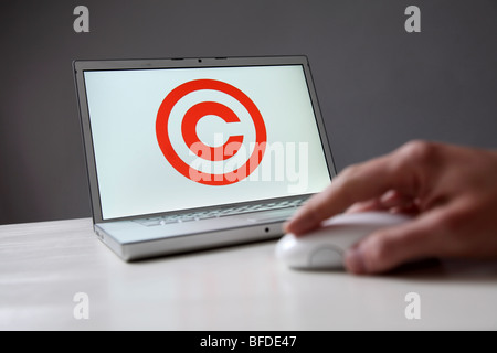 Copyright sign on computer screen. Symbol: protection of the coparight in the Internet and of digital data