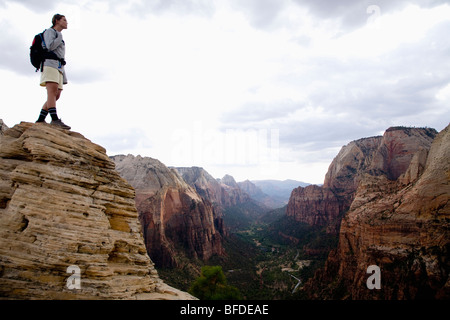 A female hiker enjoys the view from the top of Angel's Landing Trail, Zion National Park, Utah. - Stock Photo