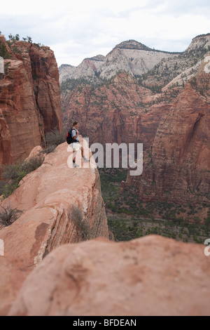 A woman overlooking Zion National Park on the Angel's Landing Trail, Zion National Park, Utah. - Stock Photo