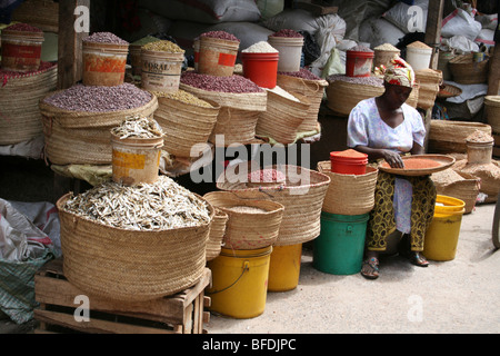 Tanzanian Woman Selling Dried Fish And Beans For Sale In Arusha's Central Market, Tanzania - Stock Photo