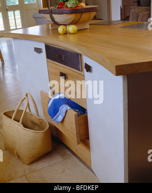 Close up of fitted kitchen unit with evoline pop up socket for Fitted kitchen drawer unit