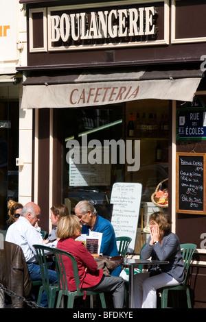 Sidewalk cafe in Paris, France. - Stock Photo