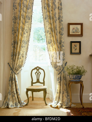 Antique Chair In Front Of Tall Window With White Voile Curtains In ...