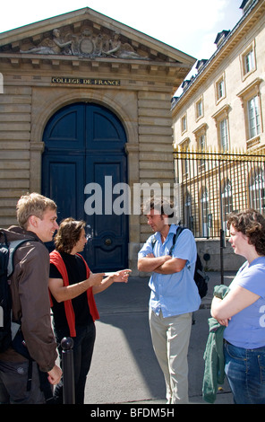 Students socialize at the College de France located in the Latin Quarter of Paris, France. - Stock Photo