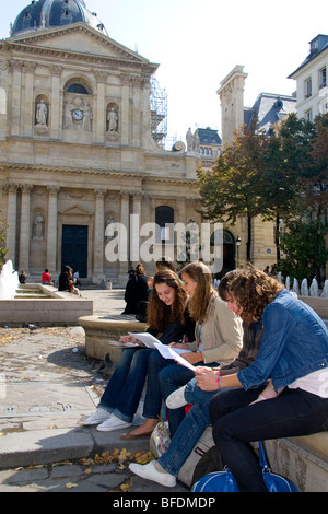 Students study near the Sorbonne in Paris, France. - Stock Photo
