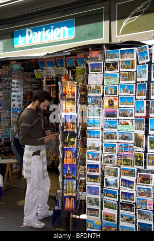 Newsstand selling postcards in the Latin Quarter of Paris, France. - Stock Photo