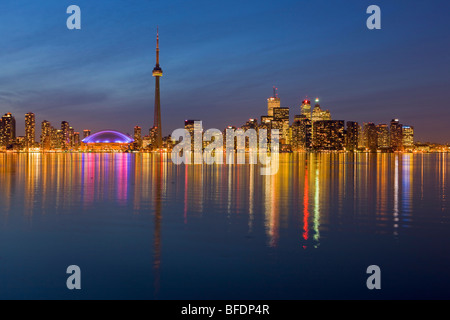 Toronto city skyline seen at dusk from Centre Island, Toronto Islands, Lake Ontario, Ontario, Canada - Stock Photo