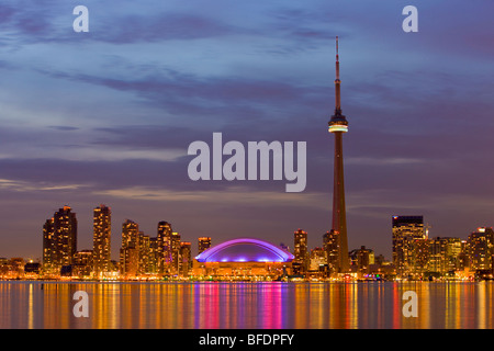 Skyline of Toronto with CN Tower and Rogers Centre at dusk, Toronto, Ontario, Canada - Stock Photo