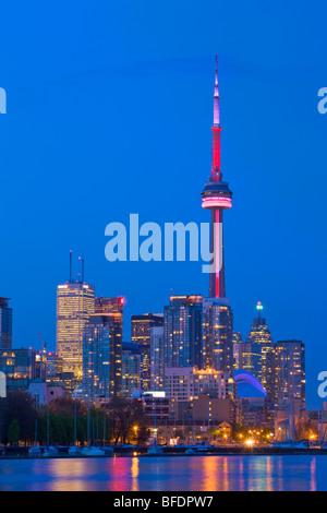 Skyline of Toronto at dusk seen from Ontario Place, Toronto, Ontario, Canada - Stock Photo