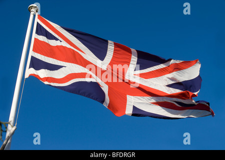 Union Jack Flag Flying on Remembrance Day - Stock Photo