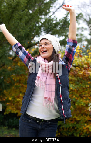 Happy girl with hat and scarf - Stock Photo