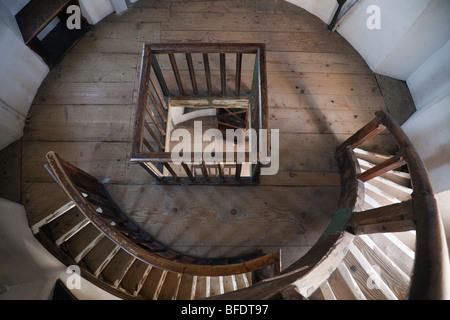 View down from above to wooden spiral staircase inside the lighthouse. Lindau, Bavaria, Germany, Europe. - Stock Photo
