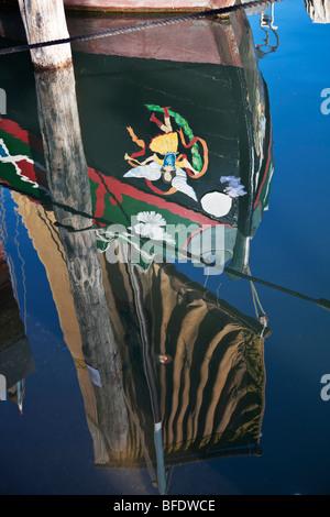 Boat reflection in the water. Chioggia, Veneto, Italy - Stock Photo