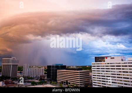 Colorful cloud formation at sunset over city of Winnipeg in Manitoba, Canada - Stock Photo