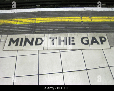 Mind the gap warning sign on the platform on the London Underground - Stock Photo