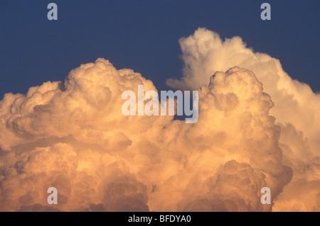 Threatening Cumulonimbus Cloud Building Against Blue Sky - Stock Photo